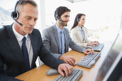 Smiling business team working hard Royalty Free Stock Images