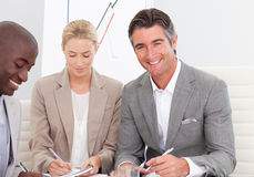 Smiling business team working together Stock Images