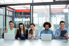 Smiling business team working together in meeting Royalty Free Stock Image