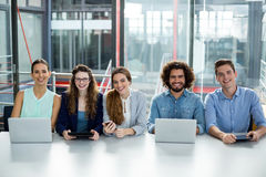 Smiling business team working together in meeting at office Royalty Free Stock Images
