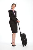 Smiling business traveller woman in black suit Stock Photos