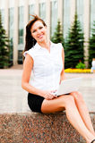 Smiling business woman. Business woman smiling working with netbook Royalty Free Stock Photography
