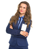 Smiling business woman with badge looking on copy space Stock Photo