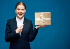 Smiling business woman black suit wearing pointing finger at gif. T box on blue Royalty Free Stock Photo