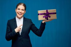 Smiling business woman black suit wearing pointing finger at gif Royalty Free Stock Images