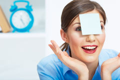 Smiling business woman with blank paper on head. Stock Photography