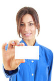 Smiling business woman in blue shirt showing blank business card Stock Photo