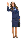 Smiling business woman with briefcase welcoming Royalty Free Stock Photography