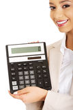 Smiling business woman with a calculator. Royalty Free Stock Image