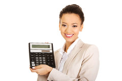 Smiling business woman with a calculator. Stock Images