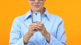 Smiling business woman chatting on smartphone, e-mail from partners, news stock video footage