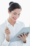 Smiling business woman with clipboard and pen Stock Image