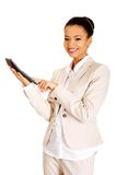 Smiling business woman counting on calculator. Stock Photo