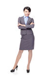Smiling business woman cross her arms Stock Image