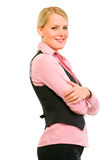 Smiling business woman with crossed arms on Royalty Free Stock Images