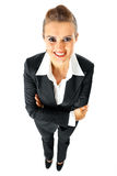 Smiling business woman with crossed arms on chest Stock Photo