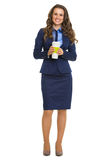 Smiling business woman with cup of hot beverage Royalty Free Stock Photos