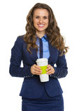 Smiling business woman with cup of hot beverage Stock Image