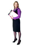 Smiling business woman with documents Stock Photos