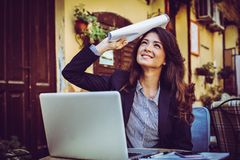 Smiling business woman with documents. stock image