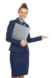 Smiling business woman with documents welcoming Stock Photos