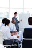 Smiling business woman doing a presentation Stock Image
