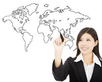Smiling business woman  drawing  global map concept Stock Photo