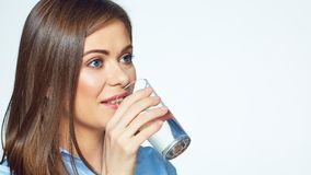 Smiling business woman drink water. White background. Isolated portrait stock photo