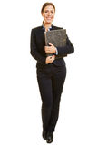 Smiling business woman with files Stock Image