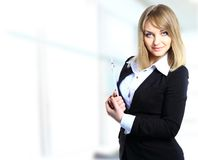 Smiling business woman with folded hands against white background Stock Photography