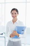 Smiling business woman with folder in office Royalty Free Stock Photos