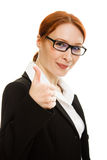 Smiling business woman gesture shows okay. Royalty Free Stock Image