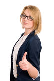 Smiling business woman gesture shows okay Stock Photography