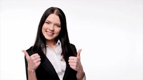 Smiling business woman gesturing thumbs up stock video footage