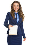 Smiling business woman giving book Stock Images
