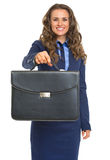 Smiling business woman giving briefcase Stock Images