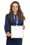 Smiling business woman giving clipboard for sign Royalty Free Stock Images
