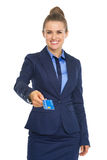 Smiling business woman giving credit card Stock Photography