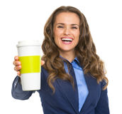 Smiling business woman giving cup of hot beverage Stock Image