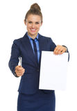 Smiling business woman giving document and pen Stock Image