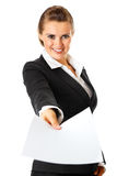 Smiling business woman giving empty white paper stock photos