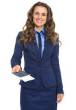 Smiling business woman giving passport with air tickets Stock Photo