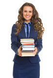 Smiling business woman giving stack of books Royalty Free Stock Photos