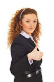 Smiling business woman giving thumbs Royalty Free Stock Photos