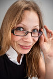 Smiling business woman in glasses Stock Image