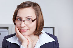 Smiling business woman with glasses stock image