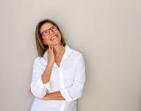 Smiling business woman with glasses looking up. Portrait of smiling business woman with glasses looking up Stock Images