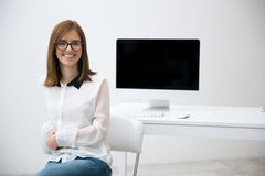 Smiling business woman in glasses at office Stock Images