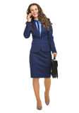 Smiling business woman going straight and talking mobile phone Royalty Free Stock Photo