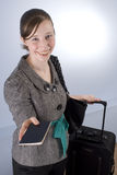 Smiling Business Woman handing over her Passport Stock Photography